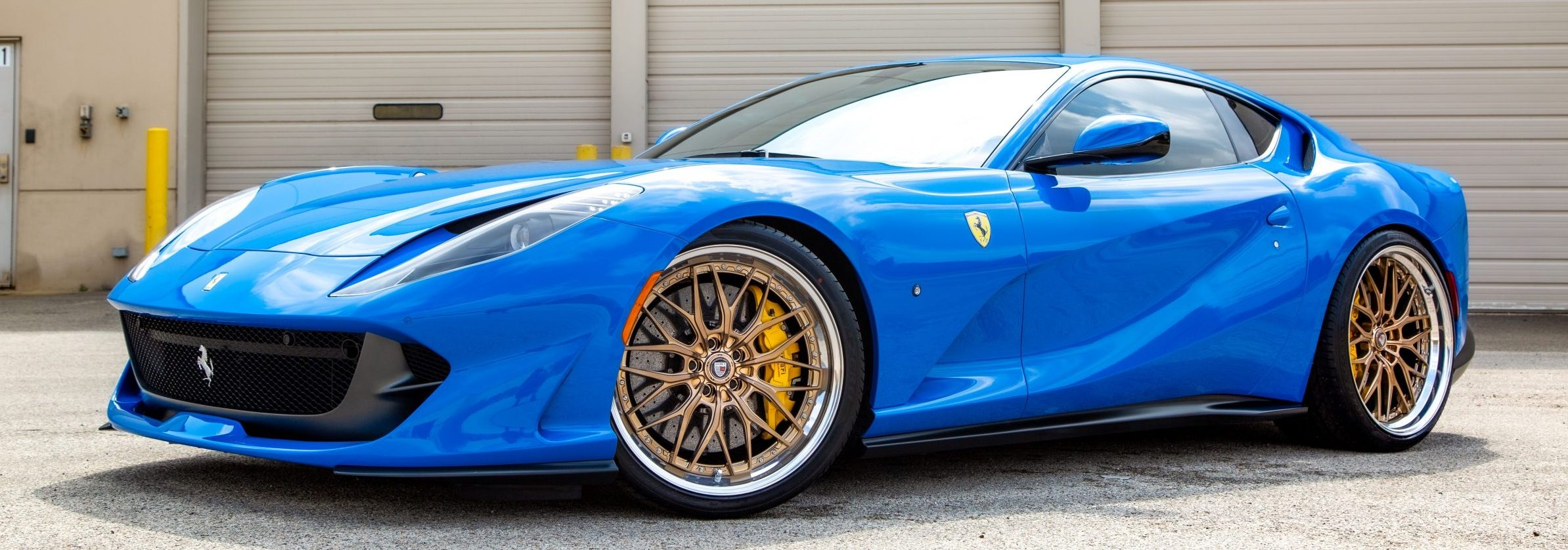 Ferrari 812 Superfast in Azzurro Dino on Anrky Wheels RetroSeries RS1 Polished Champagne with a polished lip and carbon fiber center caps - Rogue Wheels Distribution
